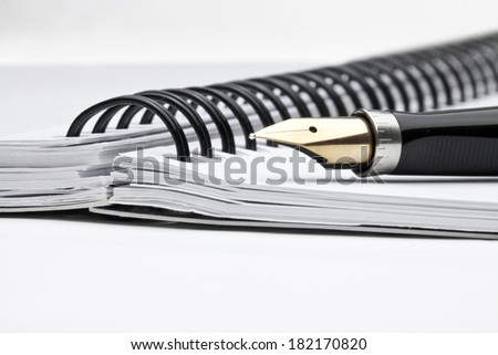 fountain pen with notebook in composition - stock photo