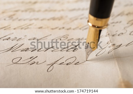 Fountain pen writing on an old handwritten letter - stock photo