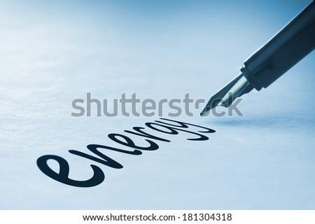 Fountain pen writing the word energy - stock photo