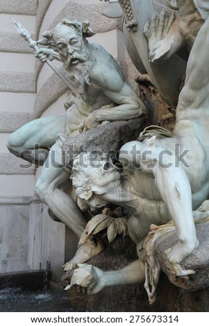 Fountain the Power of the Sea (1893) by Austrian sculptor Rudolf Weyr at Michaelerplatz near the Hofburg Palace in Vienna, Austria.  - stock photo