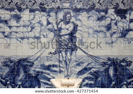 Fountain wall with historical, Portuguese, blue and white azulejo ceramic tiles depicting Neptune or Poseidon. Constancia, Santarem, Portugal.