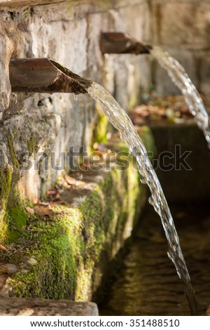 fountain water source spring in the forest - stock photo