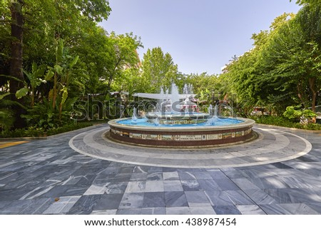 Fountain  with blue sky in Marbella, Andalusia, Spain.. - stock photo