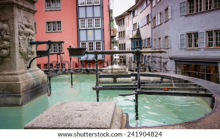 Fountain with cascade taps in the historical center of Zurich city, Switzerland  - stock photo