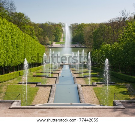 Fountain with water gushing in a nice park in France