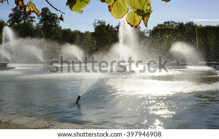 Fountains and pond in Battersea Park, London, England - stock photo