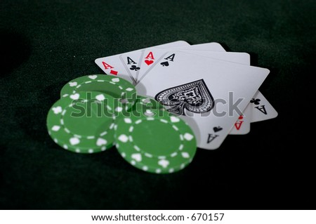 Four Aces and a stack of green poker chips.