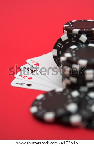 Four aces & black casino chips - shallow dof - stock photo