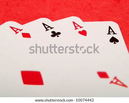 Four aces cards on a red background
