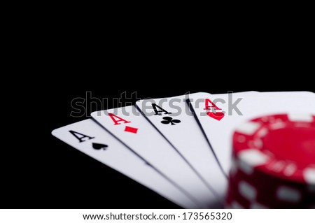 four aces high on black table with chips - stock photo