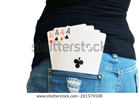 Four aces in the rear pocket of a lady in Jeans - stock photo