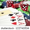 Four aces of a kind on casino chips wit two red dices - stock photo
