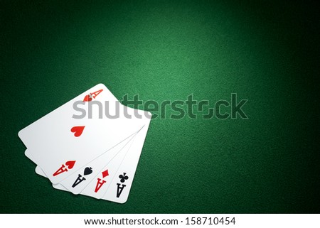 Four aces  on a green felt  - stock photo
