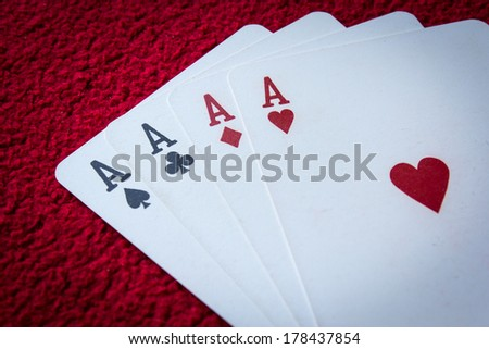Four aces  on red background - stock photo
