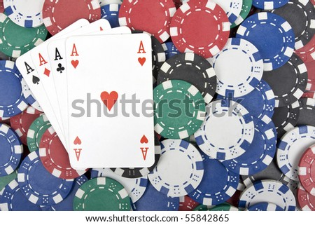 Four aces on the poker chips