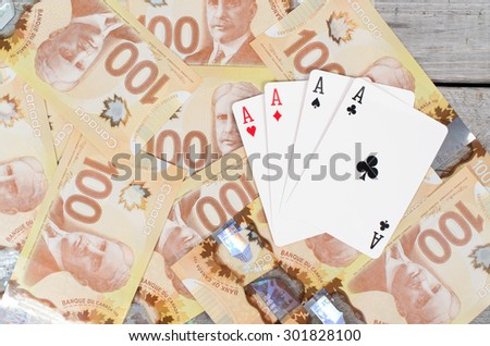 Four aces over a bunch of 100 dollars bank notes - stock photo