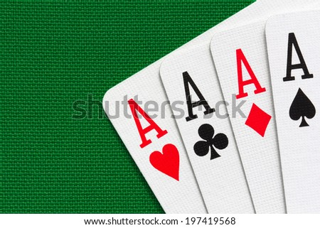 Four aces over green textile background. Close-up view. - stock photo