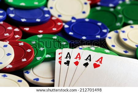 four aces with casino chips on green table - stock photo