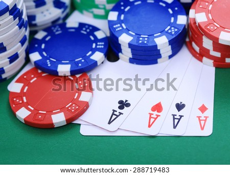 Four aces with colorful token
