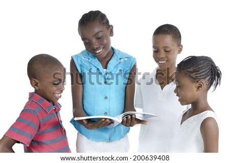Four african kids learning together, Studio Shot - stock photo
