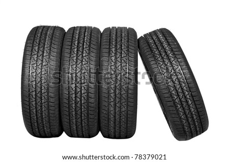 Four all-weather tyres on a white background with a protector - stock photo