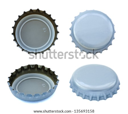 Four angles of silver colored metal caps, used for glass soda bottles. Isolated on white background. - stock photo
