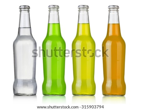 Four assorted soda bottles, non-alcoholic drinks  - stock photo