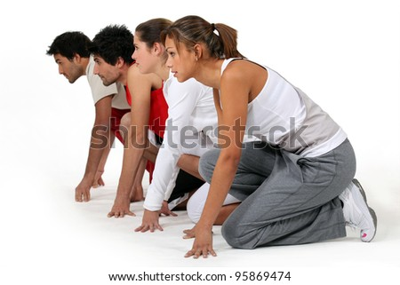 Four athletes ready for a race - stock photo