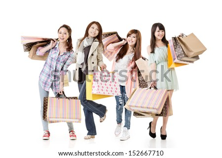 Four attractive young asian shopping women posing. Group full length portrait. Isolated on white background. - stock photo