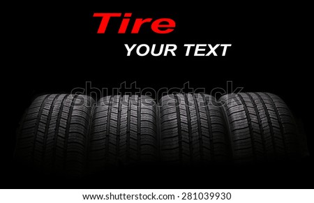 four automobile rubber tires isolated on black background - stock photo
