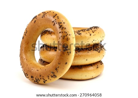 Four bagels with poppy seeds on a white background - stock photo