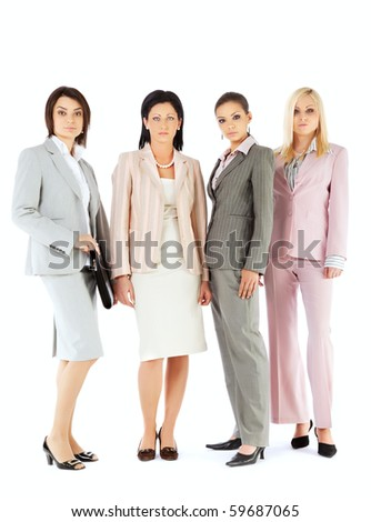 Four beautiful businesswomen team standing on white background, looking serious