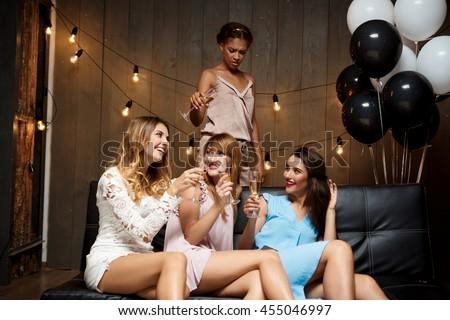Four beautiful girls resting at party.
