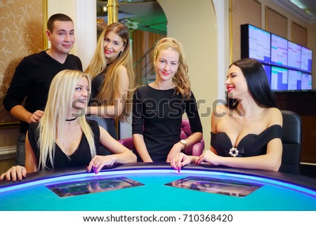 stock photo four beautiful happy women and man play poker in casino with electronic table focus on blond on 710368420 Picking Easy Products In online poker sites