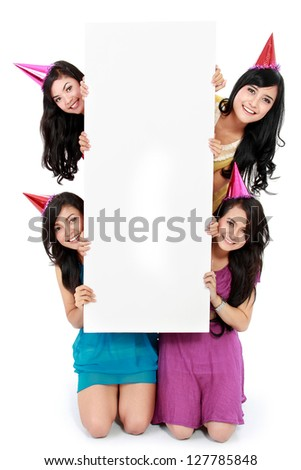 four beautiful woman holding blank board. ready for your text - stock photo