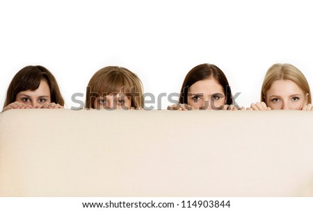 Four beautiful young girl posing on a white background - stock photo
