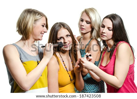 Four beautiful young girls in colorful T-shirts - stock photo