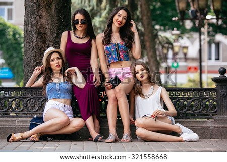 four beautiful young girls posing in the park