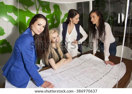 Four beauty young adult businesswomen at office working with laptop