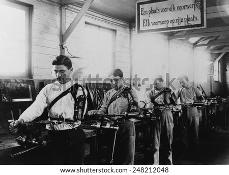 Four Belgian WW1 veterans with a prosthetic arms working in a machine shop in 1917. The occupational therapy took place at the Institute de Port Villez, Belgium.
