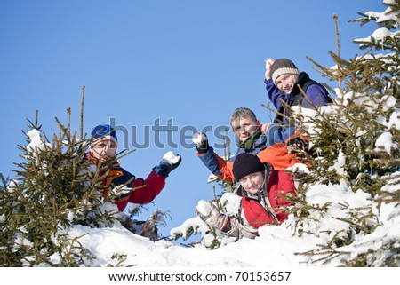 Four best friends playing whit snowball - stock photo