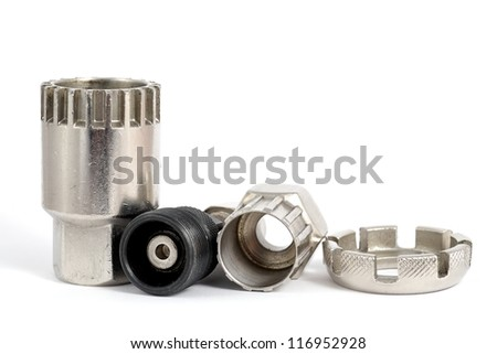 Four Bicycle special tools and extractors on a white isolated background