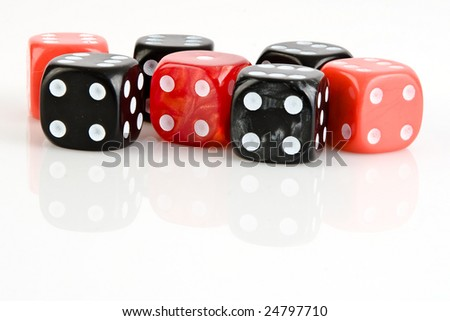 Four black and three red dices with numbers six and number one - stock photo