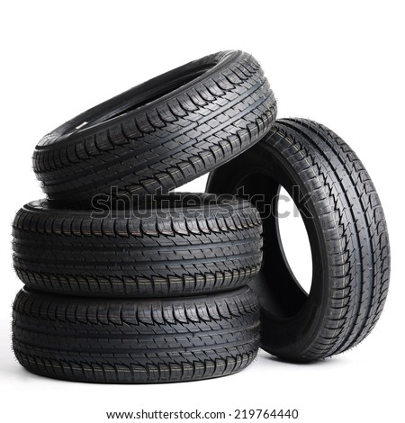 four black tires isolated on white background - stock photo