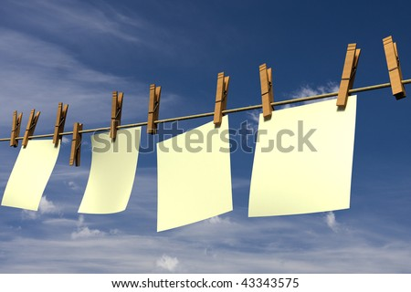 Four blank pieces of paper hanging on a clothesline