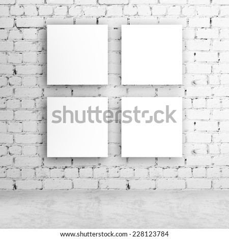 four blank poster on wall - stock photo