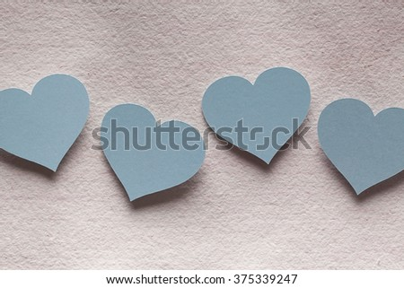 Four blue paper hearts