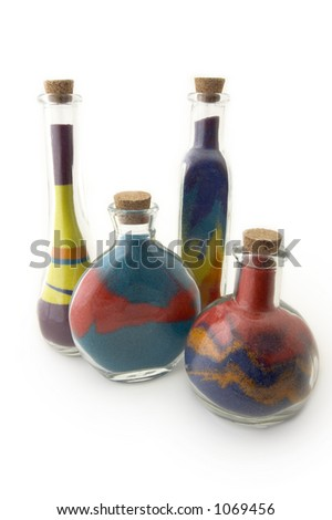 Four  bottles with colorful sand - stock photo