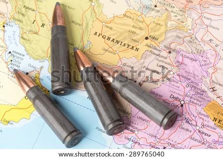 Four bullets on the geographical map of Afghanistan. Conceptual image for war, conflict, violence. - stock photo