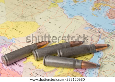 Four bullets on the geographical map of Egypt, Lybia, Algeria and Niger in North Africa. Conceptual image for war, conflict, violence. - stock photo